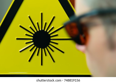 Laser safety sign and safety glases in lab