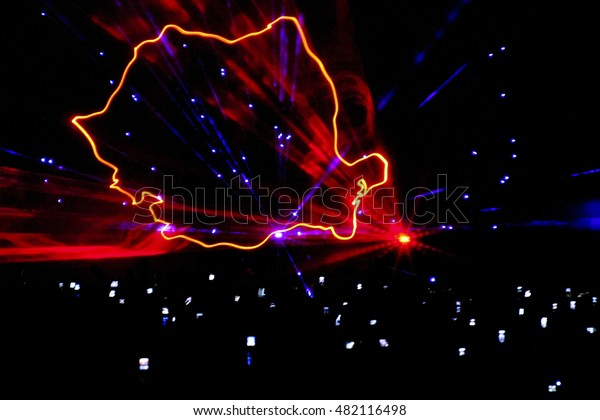A laser show rendition of the Romanian map. Drawn in the air like a computer graphic, location is an outdoor night party. Abstract