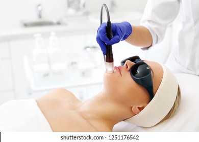 Laser skin rejuvenation. A woman in a beauty salon during a laser treatment.
