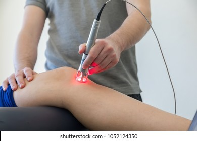 Laser therapy on a knee used to treat pain. selective focus