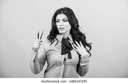 Lash applicator. Eyelash extension tweezer. Girl makeup face hold tweezer for eyelash extension. Professional makeup artist. Cosmetic tweezer tool. Beauty shop concept. Makeup false lashes volume.
