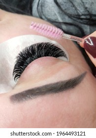 Lash extensions in beauty salon macro eye top view