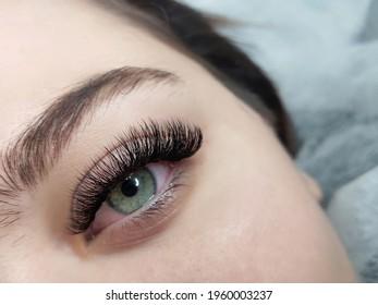 Lash extensions macro eye top view, copy space