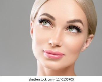 Lashes extension woman face beautiful eyes female face skin care beauty