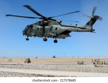 LASHKAR GAH, HELMAND PROVINCE - 24 MARCH 2013:  An Augusta Westland Merlin HC3 from 78 Squadron RAF flares for landing at a forward operating base.  The military continue to be involved in operations.