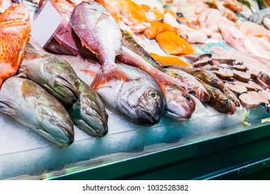 Las-Palmas de Gran Canaria, Spain, on January 12, 2018. Fresh fish and seafood are laid out on a show-window of shop in the central market
