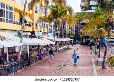 Las-Palmas de Gran Canaria, Spain, on January 10, 2018. People eat and have a rest in cafe on the embankment near the Playa de Las Canteras beach