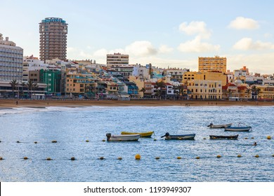 Las-Palmas de Gran Canaria, Spain, on January 10, 2018. Winter view of the Atlantic Ocean and embankment in the distance. Fishing boats on water