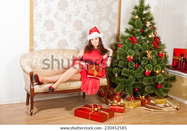 lass wearing red dress and Christmas hat