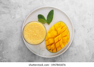 Lassi is a popular traditional cold drink with mango in India. Lassi consists of yogurt, water, spices and sometimes fruit and ice, top view - Shutterstock ID 1947841876