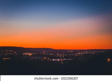 The last bit of light fades behind distant hills in Kerrville, TX.