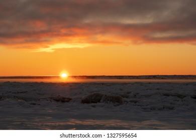 Last bit of sun over a snowy landscape