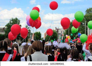The last call at school. Parade of schoolchildren, graduates with bright balloons colorful in hands.