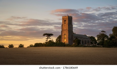 Last evening light on the church of St Peter and St Paul in Honing.