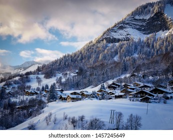 Last light of the day catches the fresh snow blanketing the pretty village of Flumet in the Auvergne-Rhône-Alpes, France. January 2019.