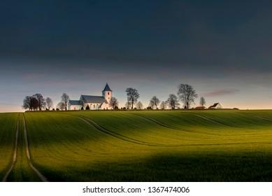 Last light on Tamdrup Church, dating back to 1142 in Jutland, Denmark.