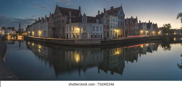 Last lights of sunset on the medieval buildings of the city centre reflected in the canals Bruges West Flanders Belgium Europe