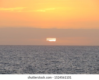 Last moments before the sun dipped into the Atlantic Ocean. A beautiful sunset on the coast of Gran Canaria, Spain.