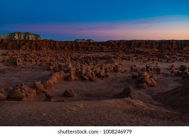 The last moments of sun on Goblin Valley State Park in Utah USA.