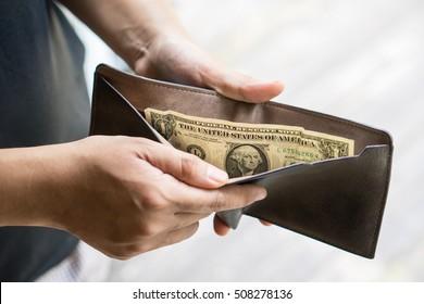 last one dollar money banknote in wallet, bankrupt concept.