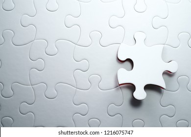 Last piece of jigsaw puzzle. Solving and completing the task.