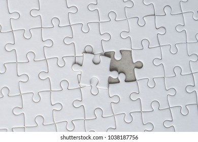 Last piece of white jigsaw is almost in place for business solution concept