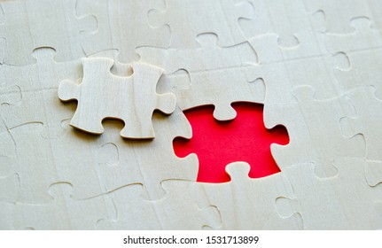 Last piece of wood jigsaw on the connected pieces with missing gap. Concept for final solution, problem solving or teamwork