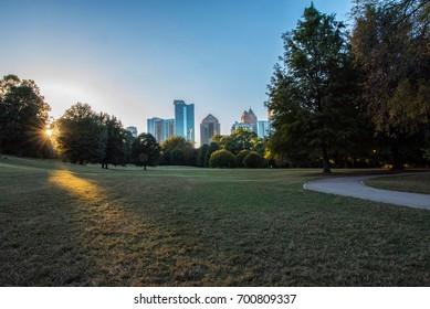 The last rays of sun poke through trees in Atlanta's Piedmont Park