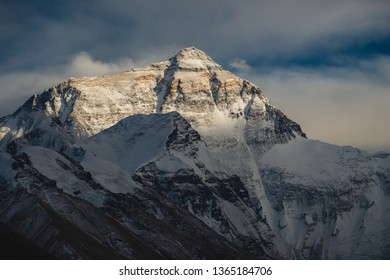 The last rays of sunlight stretch across the peak of Mount Everest in Tibet, China.