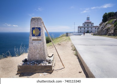 the last scallop shell pointer with a walking stick of the christian pilgrimage route of the camino de santiago at finisterre, considered the end of the world in medieval times, spain