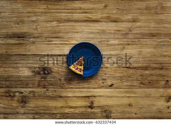 Last Slice of Pizza on Blue Plate