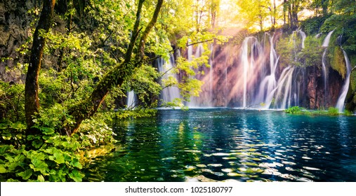 Last sunlight lights up the pure water waterfall on Plitvice National Park. Colorful spring panorama of green forest with blue lake. Great countryside view of Croatia, Europe. Orton Effect.