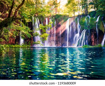 Last sunlight lights up the pure water waterfall on Plitvice National Park. Colorful spring scene of green forest with blue lake. Great countryside view of Croatia, Europe.