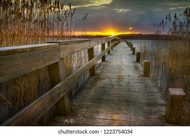 The last of the sun's rays on a pier at Skanderborg, Jutland, Denmark
