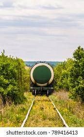 Last wagon cistern of freight train on a single track railroad