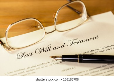 Last will and testament with pen and glasses concept for legal document
