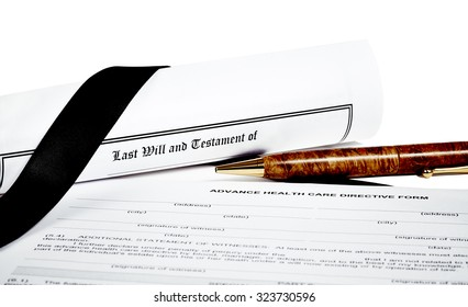 Last Will and Testament rolled up with pen isoated on white with a black ribbon and Advance Health Care Directive