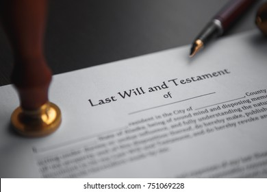 Last will and testament with wooden judge gavel; document is mock-up not rea