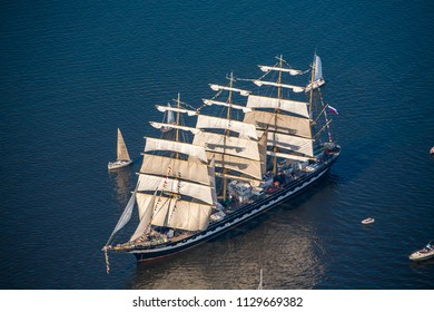 The last windjammer bark Kruzenstern. A large sailboat goes along the water area of the Daugava River.