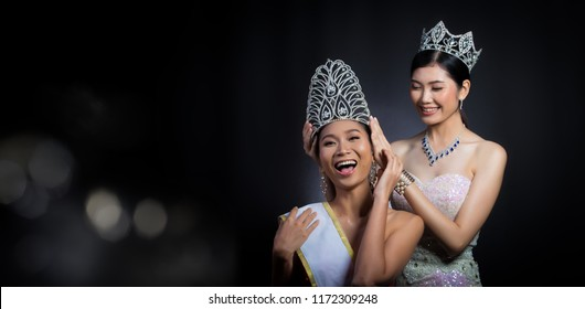 Last year winner Miss Beauty Pageant Contest put Diamond Crown on Final Winner latest year Miss Beauty Queen Pageant Contest with feeling wow smile glad face expression, two asian women moment session