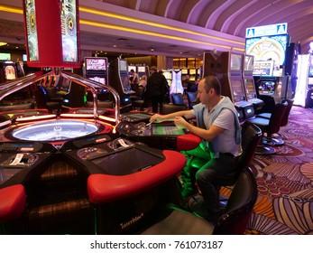 LAS-VEGA OCTOBER 31 2017: Man play semi-digital rolette in a casino