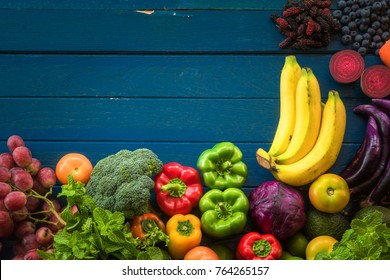 lat lay of fresh  fruits and vegetables for background, Different fruits and vegetables for eating healthy, Colorful fruits and vegetables on blue plank background