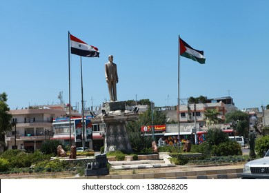 LATAKIA, SYRIA- JULY 16: The square in Latakia, the monument of Hafez al-Assad, the founder of Syria. Latakia is one of the important cities of Syria. The Photo Taken, JULY 16, 2012.