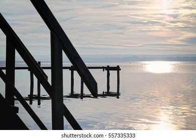 Late afternoon at a lake called Ammersee with an old wooden landing pier, Bavaria, Germany