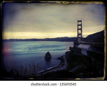 Late afternoon on a cloudy day above the San-Fransisco bay and Golden Gate bridge. Image stylized with vintage instant film aesthetics.