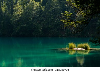 A late afternoon scene at one of the Laghi di Fusine in Northern Italy