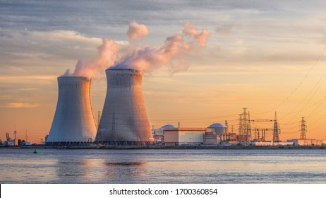Late afternoon scene with view on riverbank with nuclear reactor Doel, Port of Antwerp, Belgium. - Shutterstock ID 1700360854