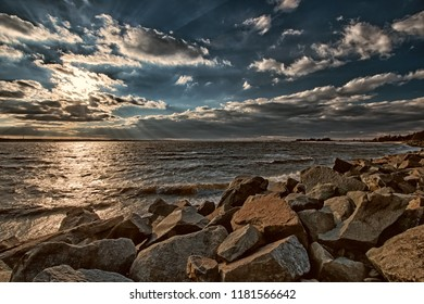 Late afternoon sun and clouds over Horseshoe Cove at Sandy Hook National Recreation Area in Highlands, New Jersey.