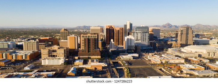 Late afternoon sun lights the buildings in the downtown urban core of Phoenix Arizona