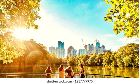 Late afternoon sun scenery view of trees and Beautiful skyline View and lake from Piedmont park, Midtown, Atlanta, GA, United State - October 14, 2018.